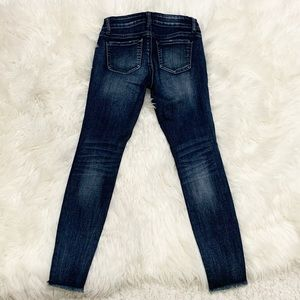 Wax Jeans dark wash distressed hem skinny jeans